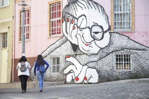 Two girls walk by Big Momma in Valparaíso, Chile