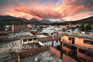 A sunset explodes over the Peruvian city of Huaraz